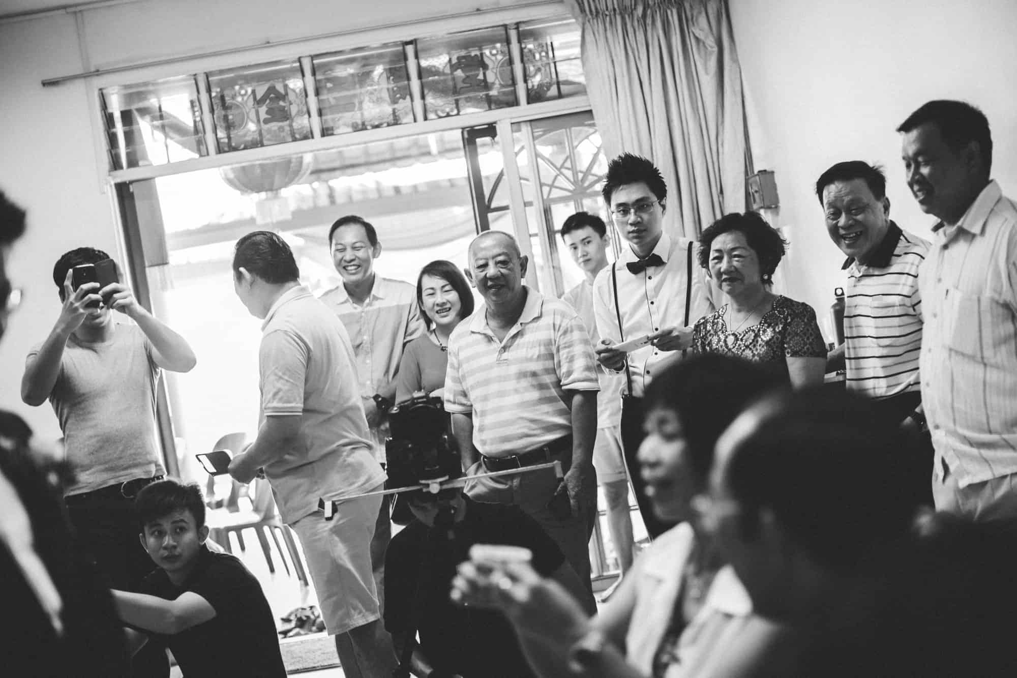 Johor malaysia wedding photograph kuala lumpur cliff choong photography gate crashing game groom brdie holding hands love kombi tea ceremony parents laugh joy