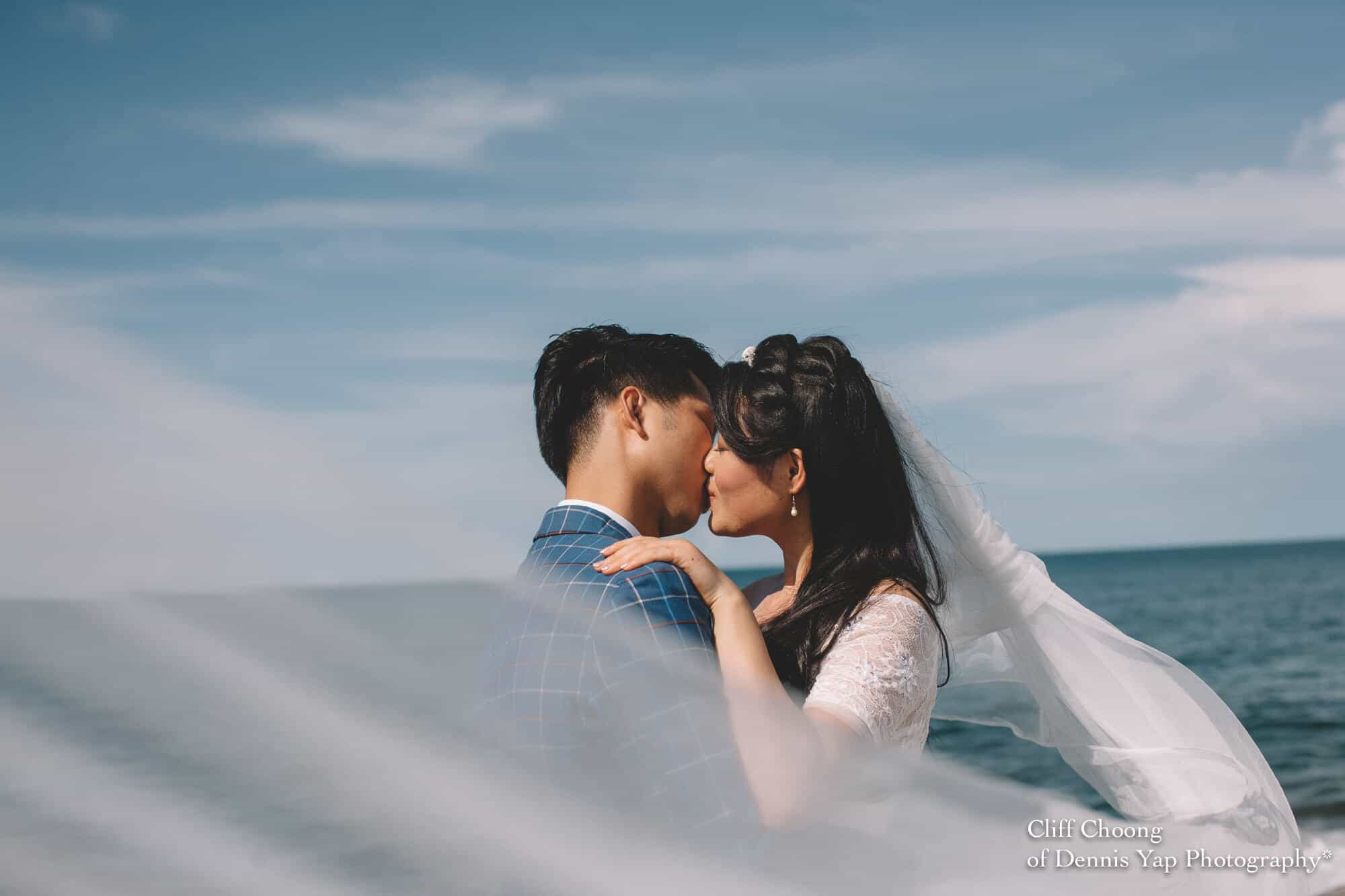 Malaysia Best Prewedding Destination Kota Kinabalu Engagement Photography Cliff Choong wedding photographer nature beach cloud blue sky kiss couple hug