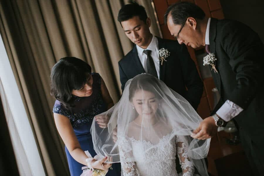 Wedding St. Andrew Church Kuala Lumpur Cliff Choong Photography bride bridesmaids groom getting ready makeup lips red white fairy tail beautiful wedding gown dress Malaysia Classic Simple elegant