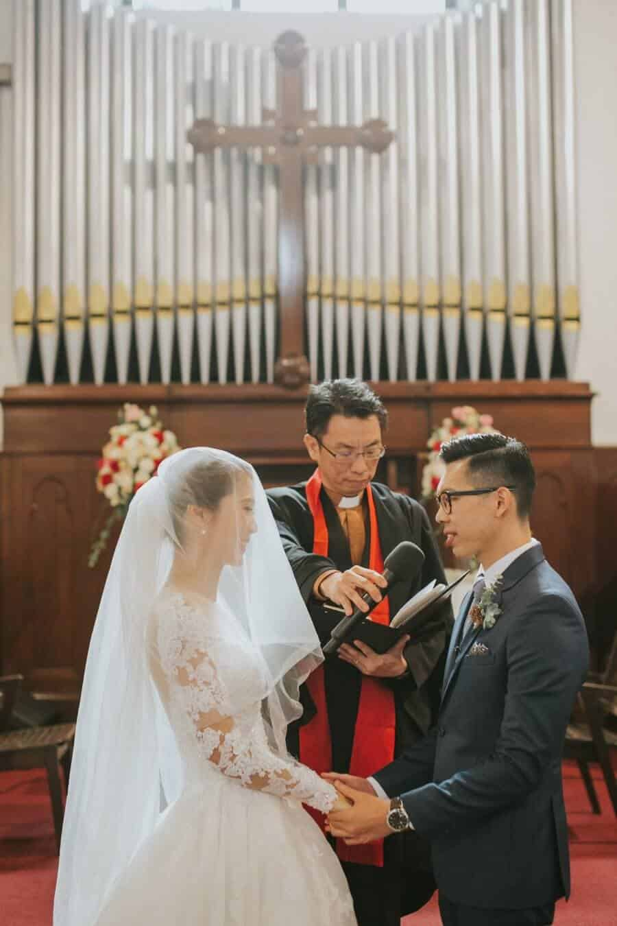 Wedding St. Andrew Church Kuala Lumpur Malaysia Destination Cliff Choong Photography bride getting ready makeup lips red white fairy tail beautiful wedding gown dress Classic Simple elegant