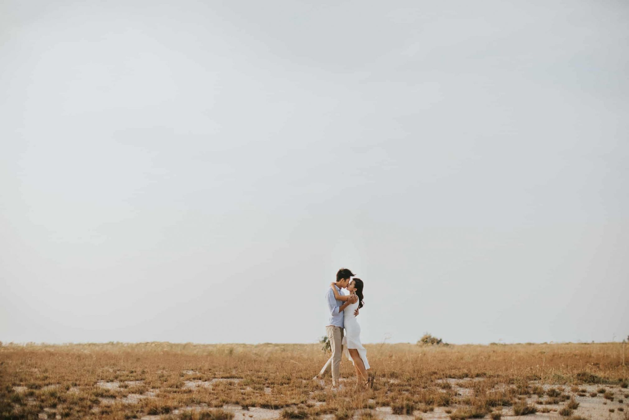 cliff choong destination portrait and wedding photographer malaysia kuala lumpur prewedding sunset golden sunrise shots bride and groom yellow grass couple kiss romantic intimate moment scene