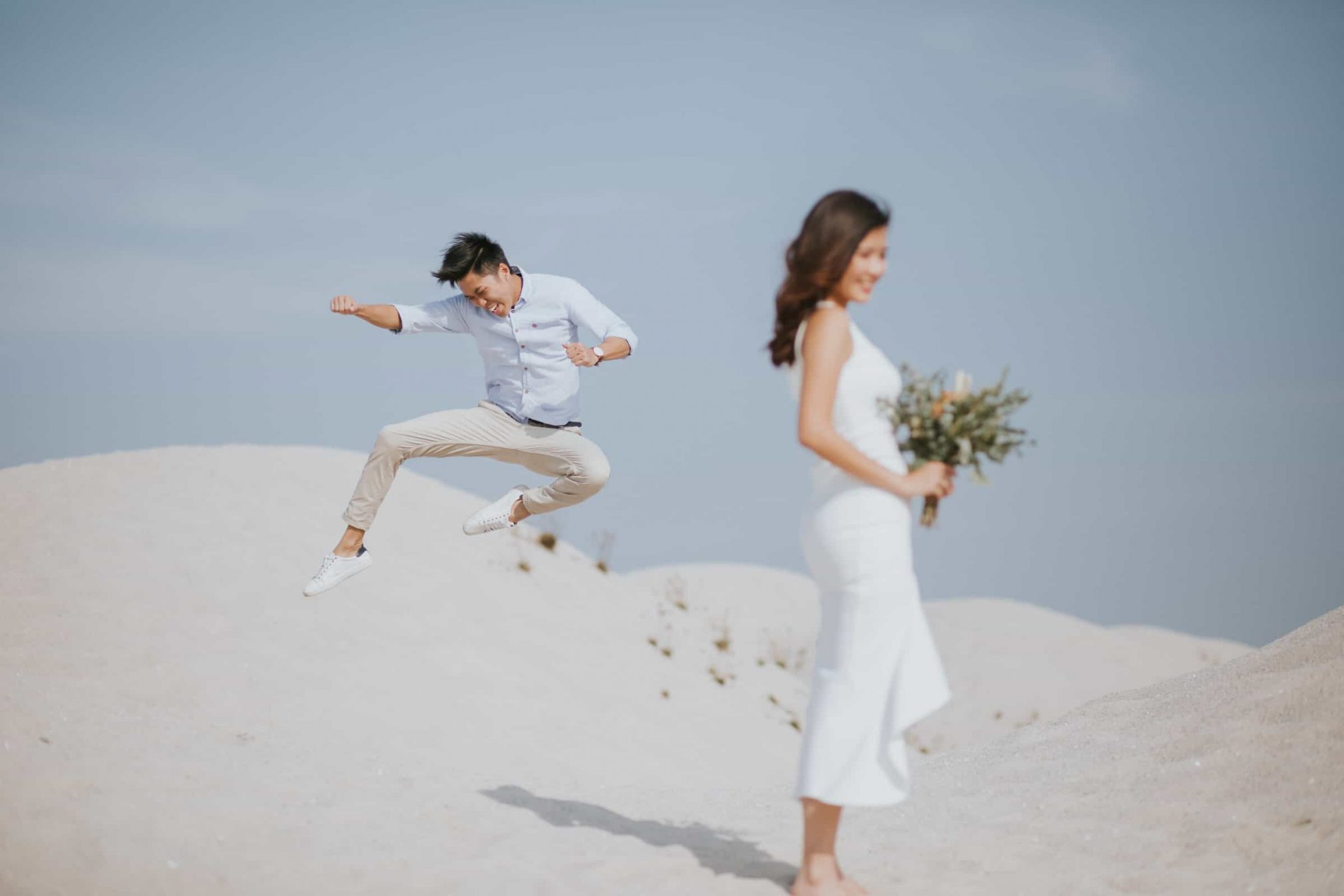 cliff choong destination portrait and wedding photographer malaysia kuala lumpur prewedding sunset golden sunrise shots bride and groom melaka desert couple kiss romantic intimate moment scene sands