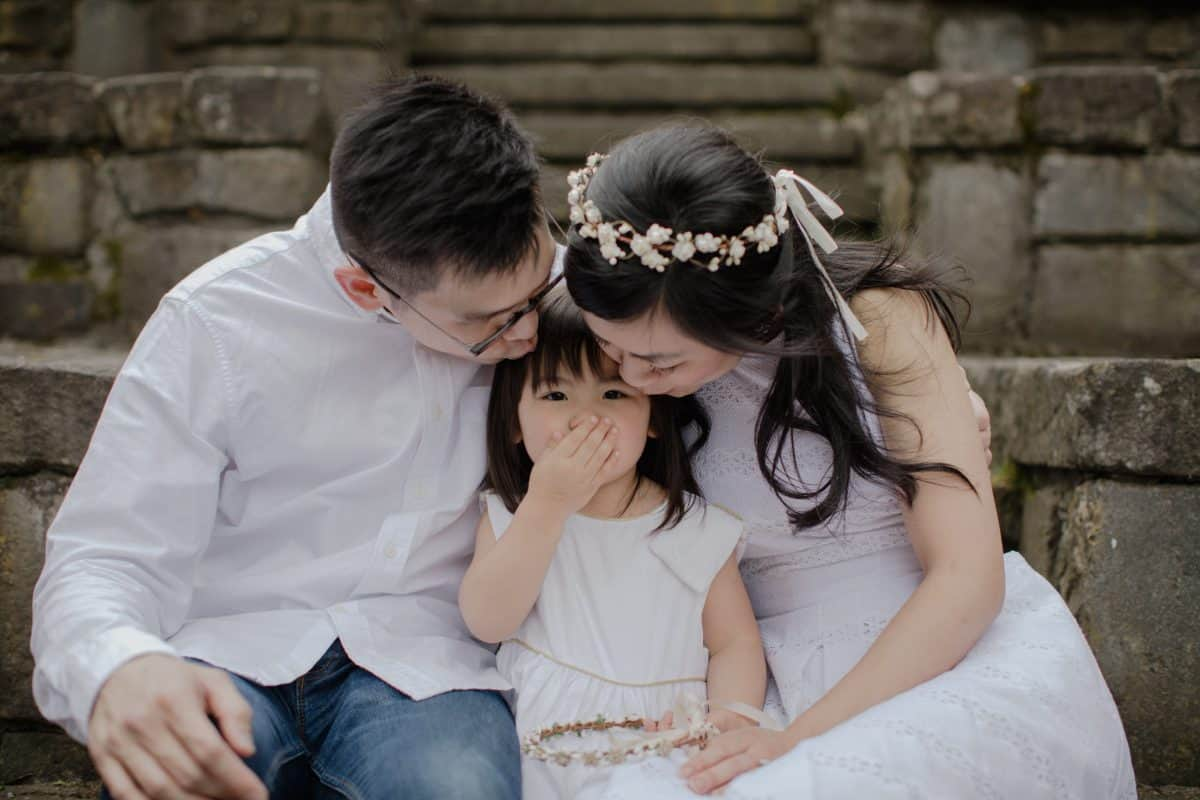 Happy Family Portrait Session With fun relax casual cozy lifestyle playful at the green park