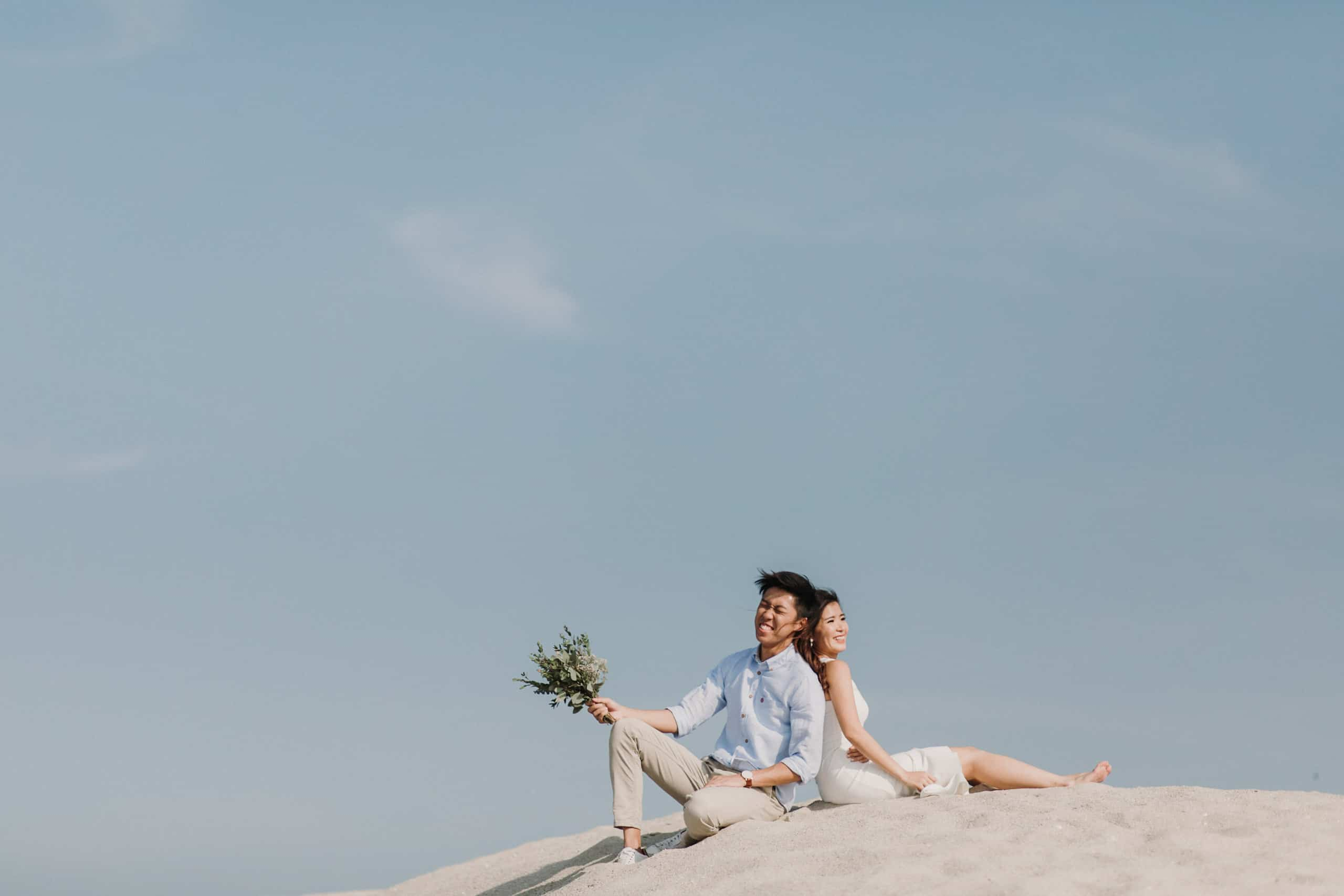 cliff choong destination portrait and wedding photographer malaysia kuala lumpur prewedding sunset golden sunrise shots bride and groom melaka desert couple kiss romantic intimate moment scene white sands