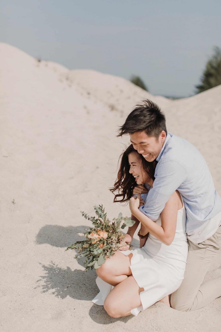 cliff choong destination portrait and wedding photographer malaysia kuala lumpur prewedding sunset golden sunrise shots bride and groom melaka desert couple kiss romantic intimate moment scene white sands rustic