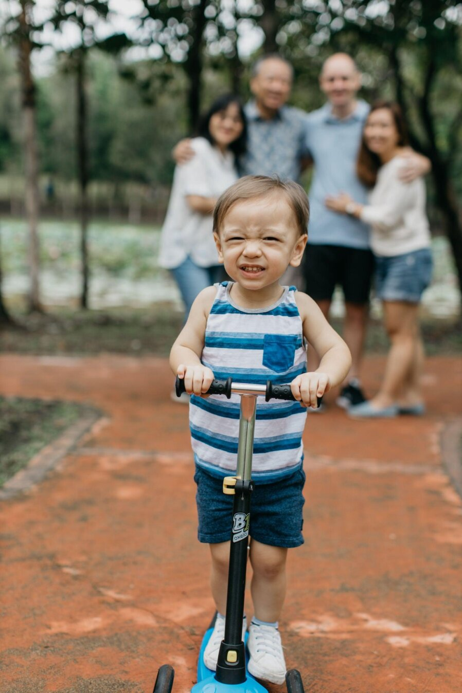 Cute little boy on scooter Damansar Tropical Family Portrait Session in Kuala Lumpur Malaysia