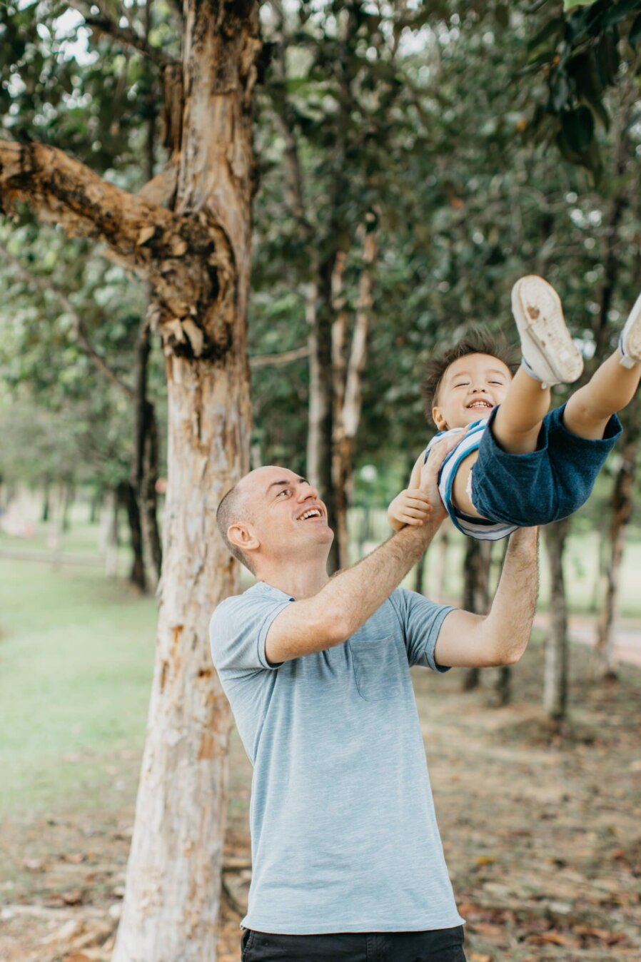 swing Cute little boy with daddy Damansar Tropical Family Portrait Session in Kuala Lumpur Malaysia