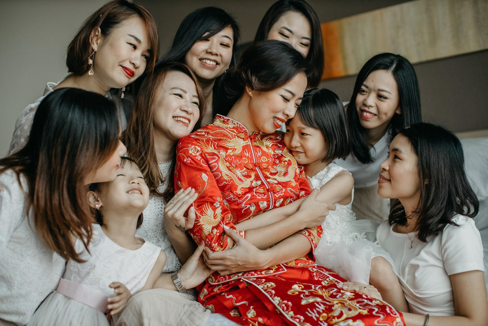 Bride on Red Chinese Kwa Moment Shot with Bridesmaids Wedding in Kuala Lumpur