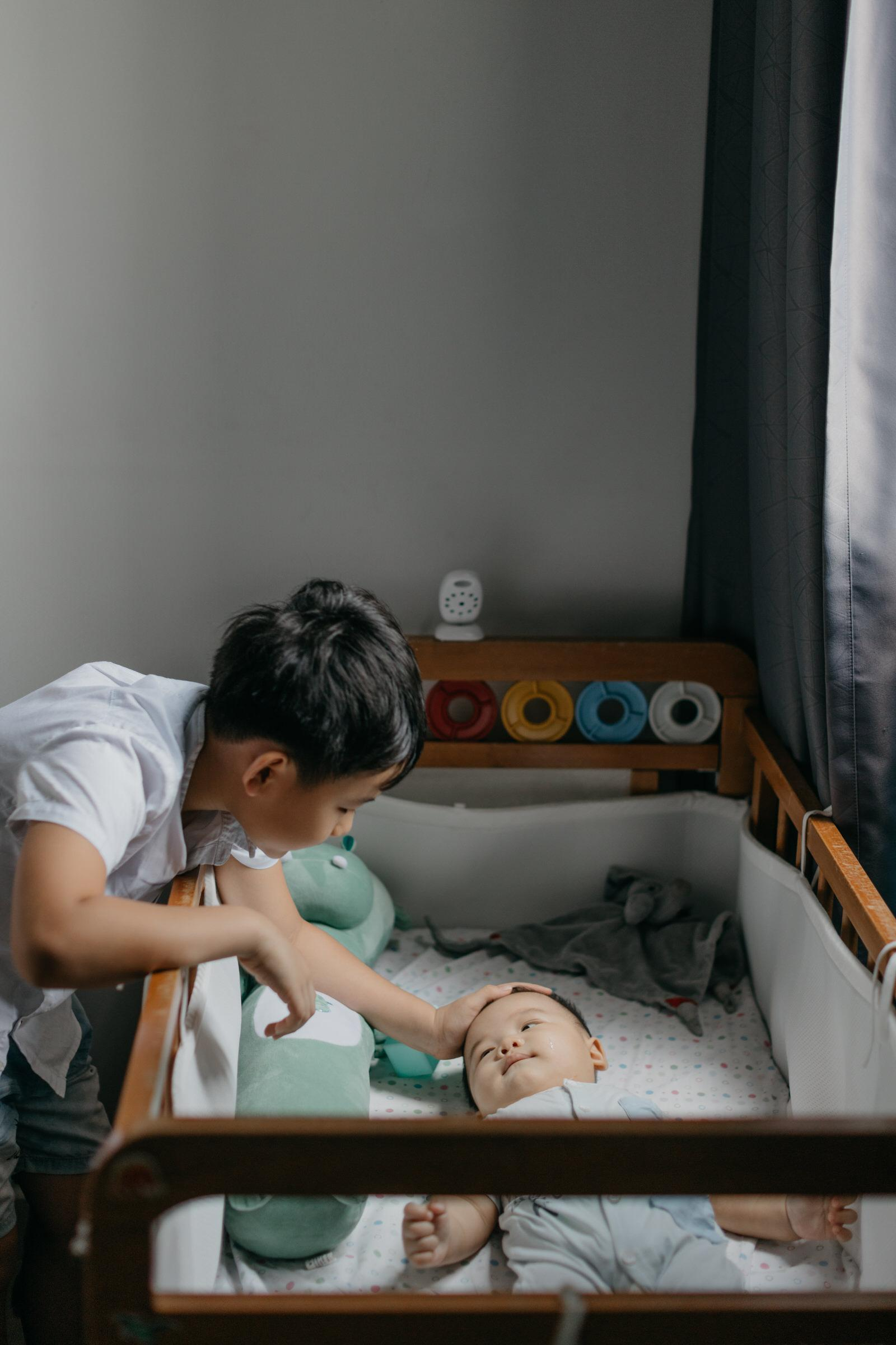 Brothers Siblings Precious time with little baby family portrait Cliff Choong Photography