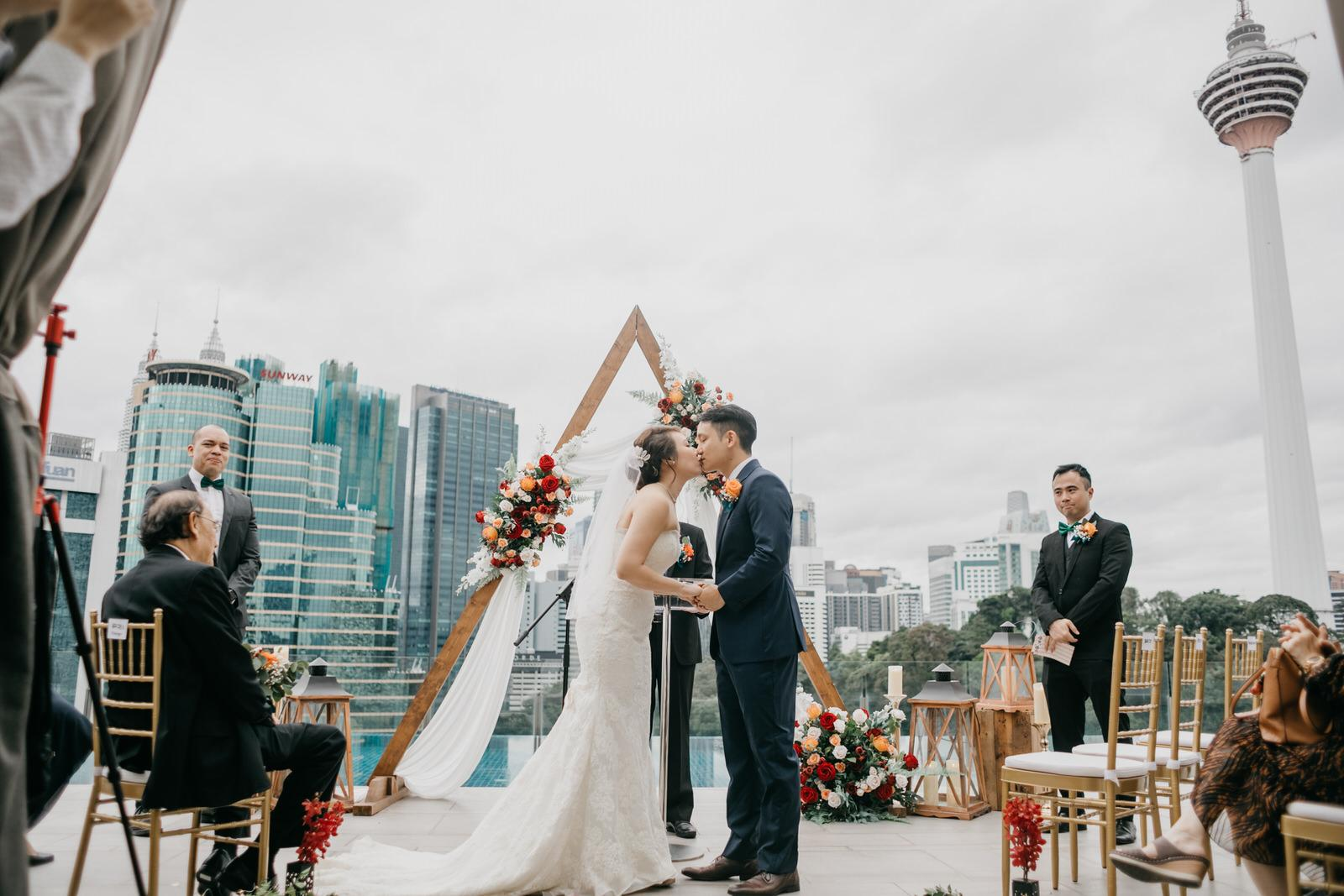 Newly wed Couple Kiss Vow Rings Exchange Boho Deco Rooftop Poolside Wedding at Hotel Stripes Kuala Lumpur MCO2.0 Cliff Choong Photography Malaysia Covid19 ROM